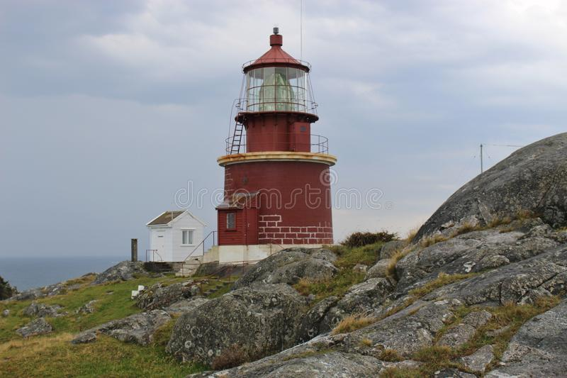 The highest-placed lighthouse in Norway, on the island Utsira. The lighthouse is situated 78 meters or 256 feet above sea Level. The small and lonely island royalty free stock image