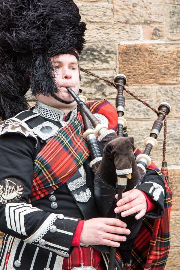A highland Bagpiper performing in Edinburgh Square stock photos