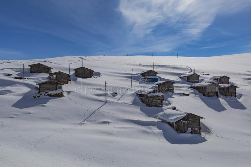 Highland houses and cloudy skies. In the snow stock photo