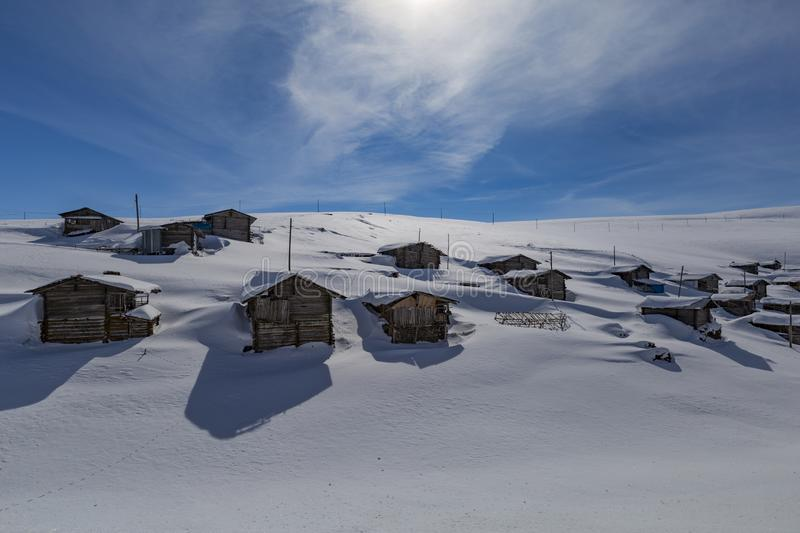 Highland houses and cloudy skies. In the snow royalty free stock photography
