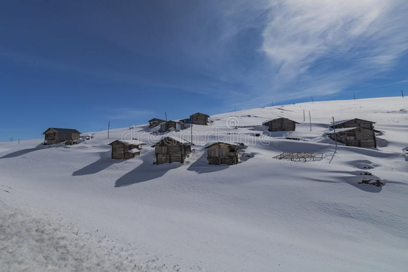 Highland houses and cloudy skies. In the snow royalty free stock photo