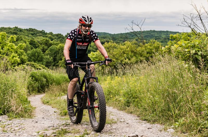 Highland Lakes State Park Mountain Biker. Pine Bush, NY /USA - June 9, 2018: Rich Cruet, owner of The Bicycle Doctor, mountain bikes at Highland Lakes State Park stock photo