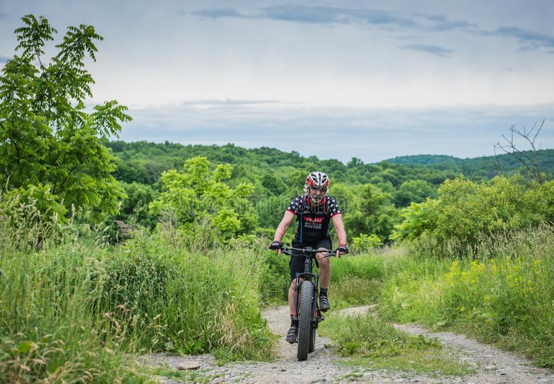 Highland Lakes State Park Mountain Biking. Pine Bush, NY /USA - June 9, 2018: Rich Cruet, owner of The Bicycle Doctor, mountain bikes at Highland Lakes State royalty free stock image