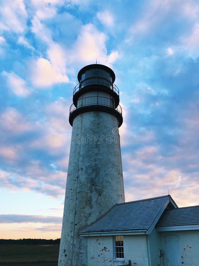 The Highland Light under sunset. The Highland Light is a lighthouse on the Cape Cod National Seashore under sunset in North Truro, Massachusetts,United States royalty free stock image