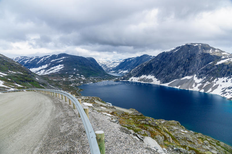 Highland road and deep blue lake. Highland road to Dalsnibba mountain and deep blue lake, Norway stock photography