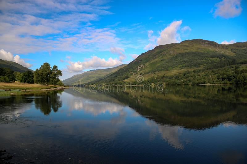 Scottish Loch on a Bright Summer Day. Highland Scottish loch on an early summer day stock images
