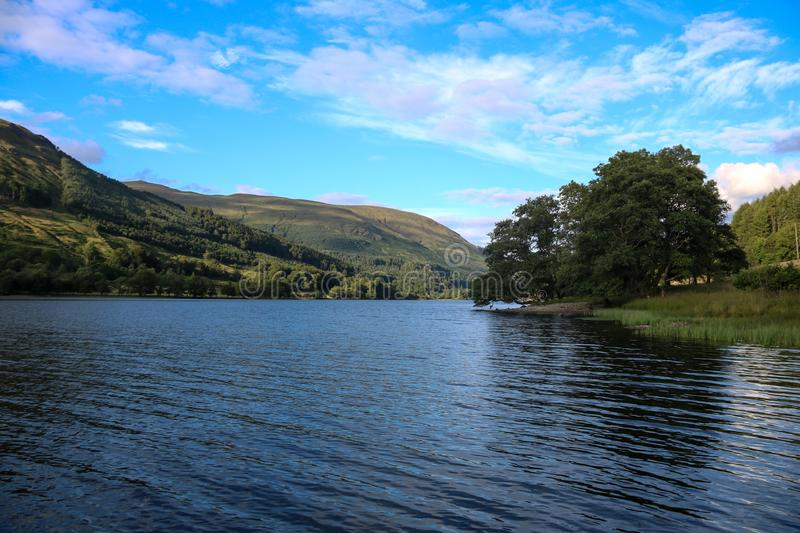 Scottish Highland Loch on a Summer Afternoon. Highland Scottish loch on an early summer evening stock image