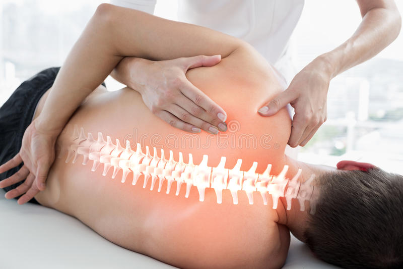 Highlighted bones of man at physiotherapy stock images