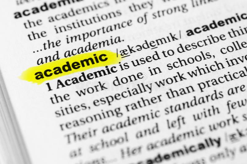 Highlighted English word `academic` and its definition in the dictionary stock images