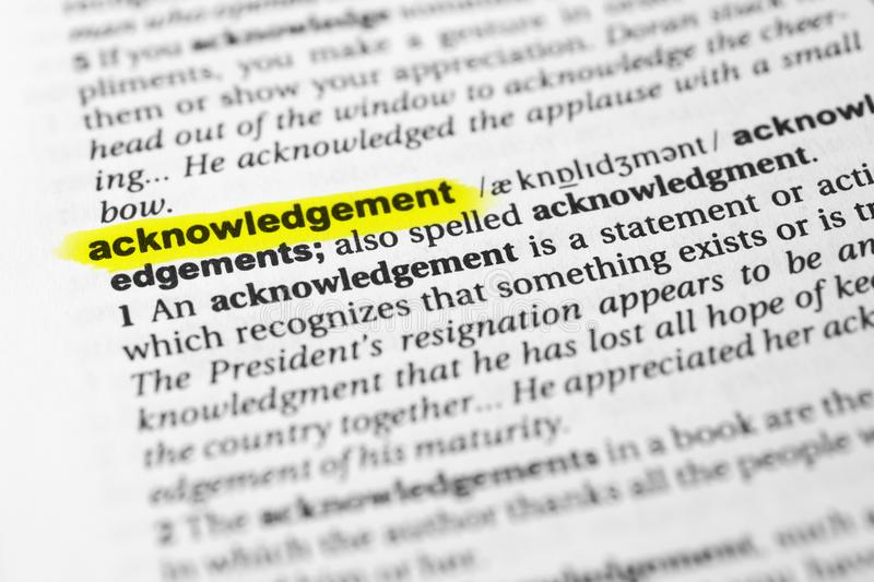Highlighted English word `acknowledgement` and its definition in the dictionary.  stock images