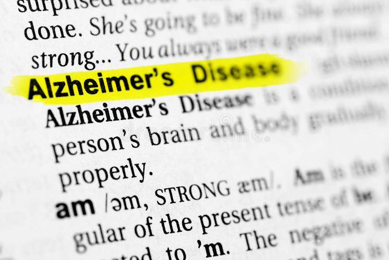 Highlighted English word `alzheimer` and its definition in the dictionary royalty free stock photo
