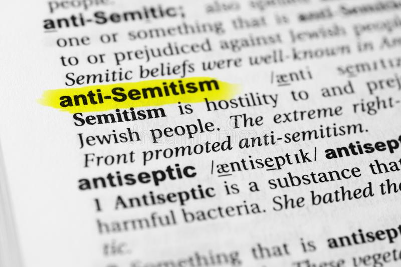 Highlighted English word `anti semitism` and its definition in the dictionary stock photography