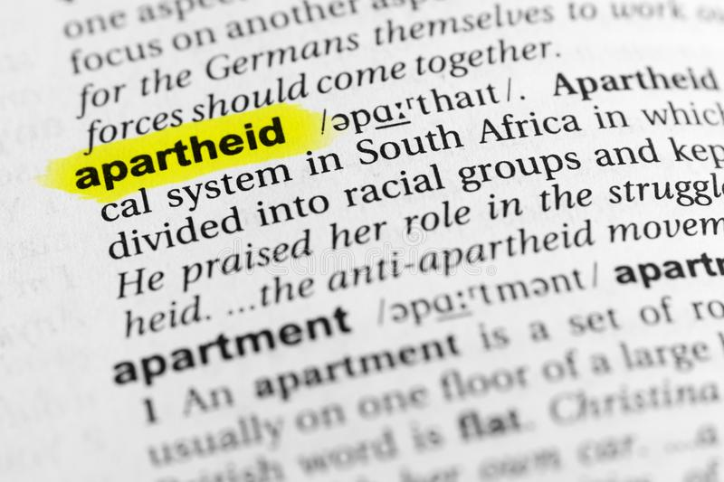 Highlighted English word `apartheid` and its definition in the dictionary.  royalty free stock photography