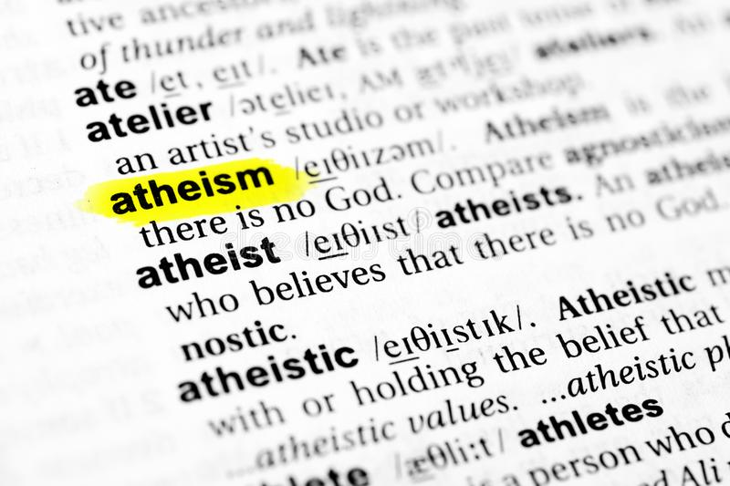 Highlighted English word `atheism` and its definition in the dictionary royalty free stock image