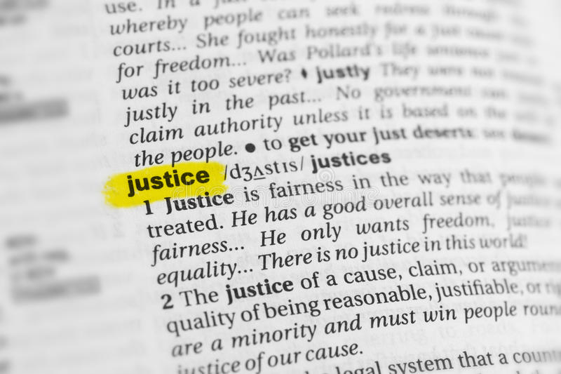 Highlighted English word & x22;justice& x22; and its definition at the dictionary stock photo