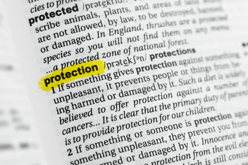 Highlighted English word `protection` and its definition at the dictionary stock photos