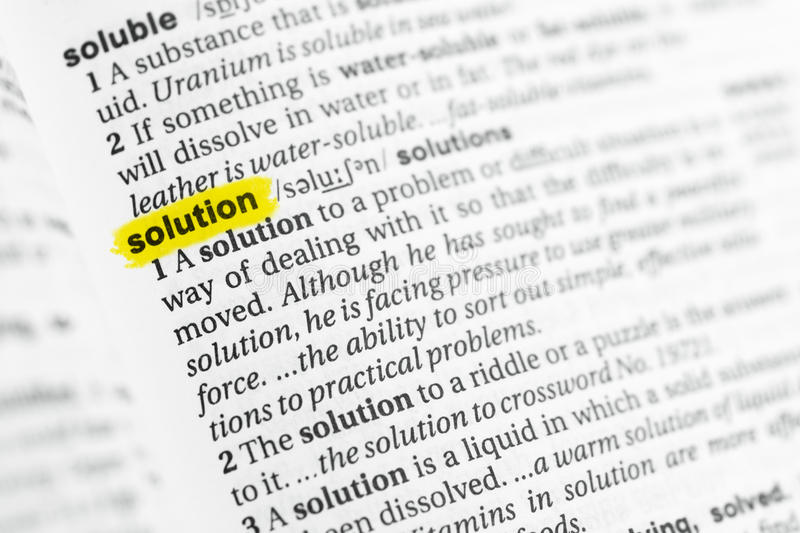 Highlighted English word & x22;solution& x22; and its definition at the dictionary stock image