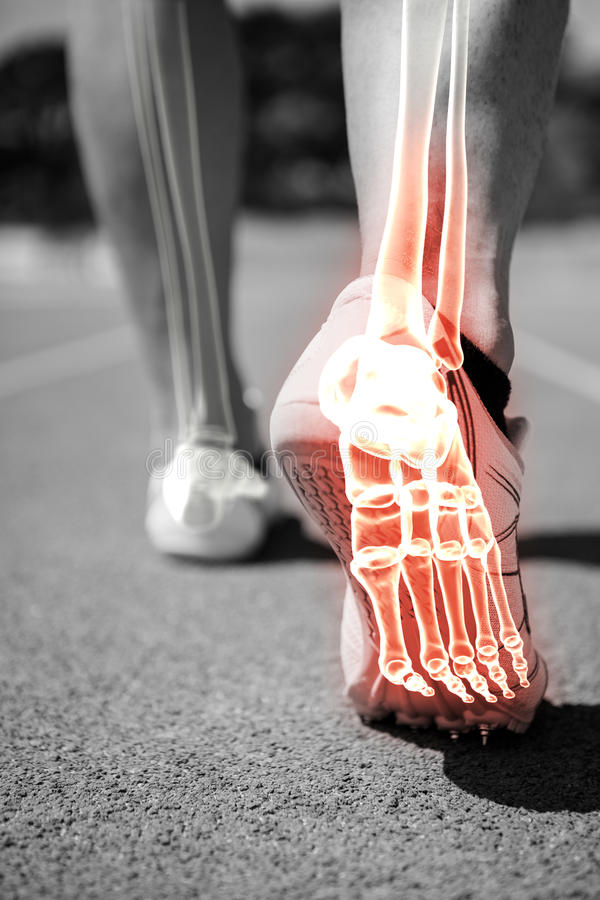 Highlighted foot bones of jogging man. Digital composite of highlighted foot bones of jogging man royalty free stock photo