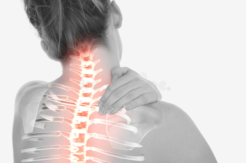 Highlighted spine of woman with neck pain stock images