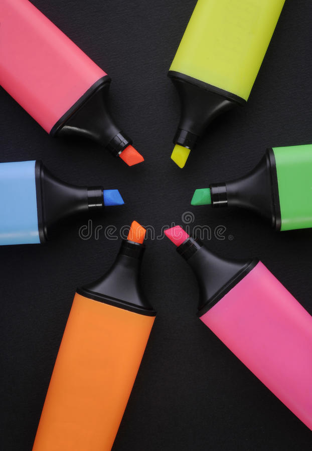 Highlighter pens. Multi colored Highlighter pens on black background royalty free stock images