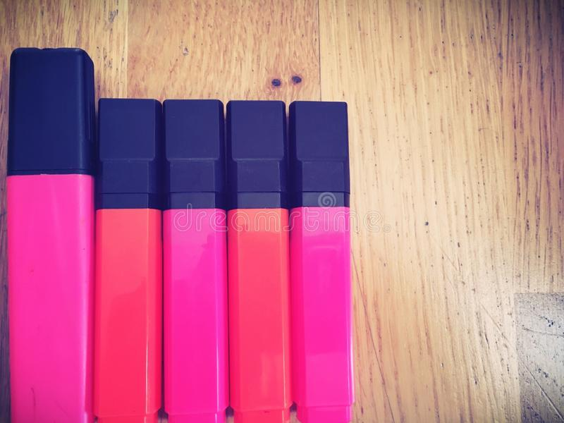 Highlighter pens. Pink and orange highlighting marker pens royalty free stock images
