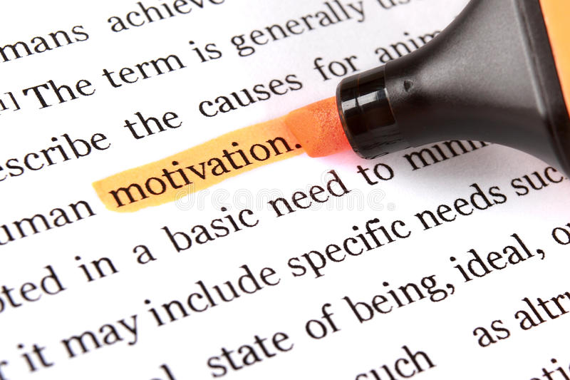 Highlighter y motivación de la palabra foto de archivo