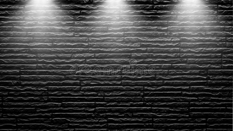 Highly contrasted spotlights on an outdoor black brick wall.  stock images