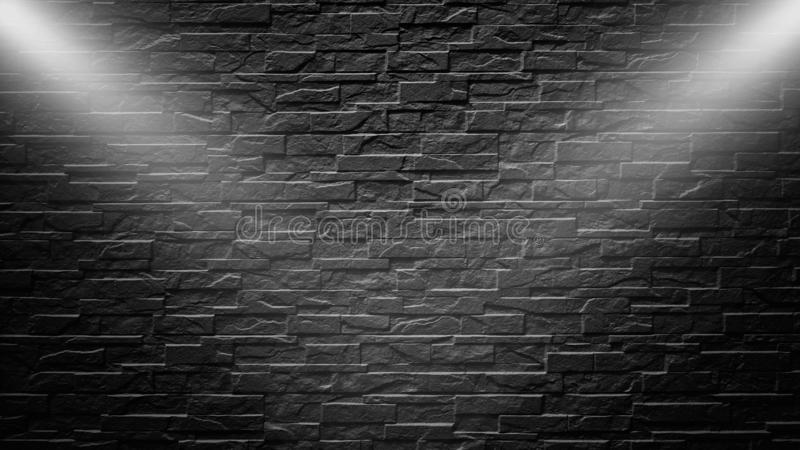 Highly contrasted spotlights on an outdoor black brick wall. Highly contrasted spotlights on an outdoor black brick wall stock photography