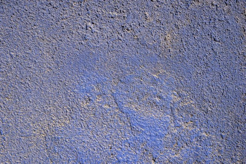 Dirty blue wall background. Highly detailed dirty blue color stucco wall background stock photography