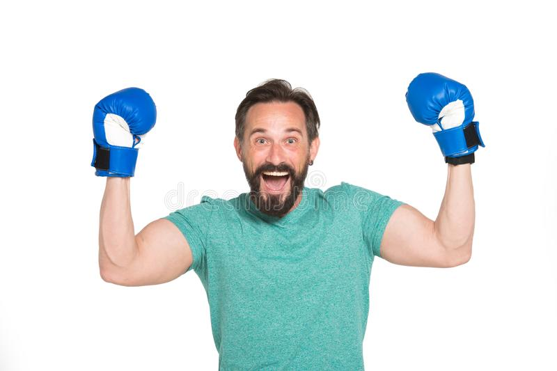 Highly emotional boxer being pleased with victory. Portrait of expressive mature boxer wearing boxing gloves and keeping arms up while showing happiness stock images