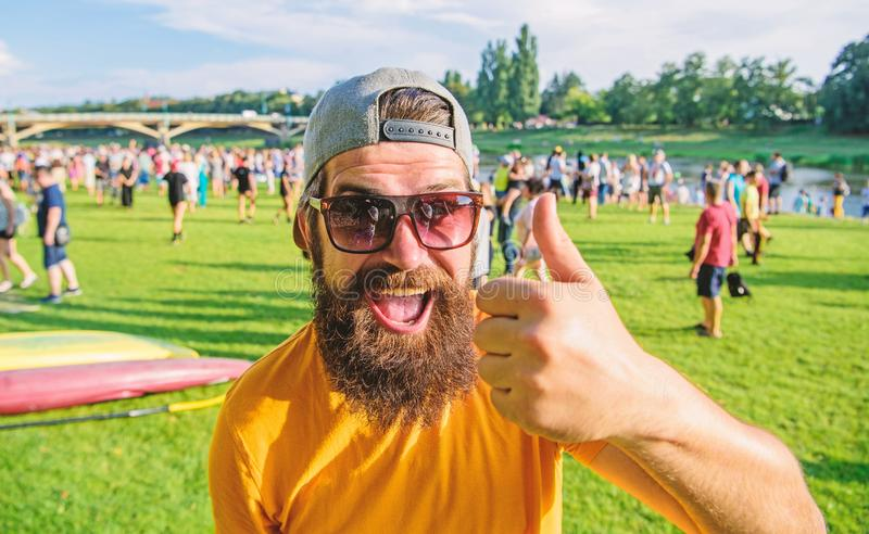 Highly recommend top list. Hipster visiting event picnic fest or festival. Man bearded in front of crowd riverside. Highly recommend top list. Man bearded in royalty free stock image