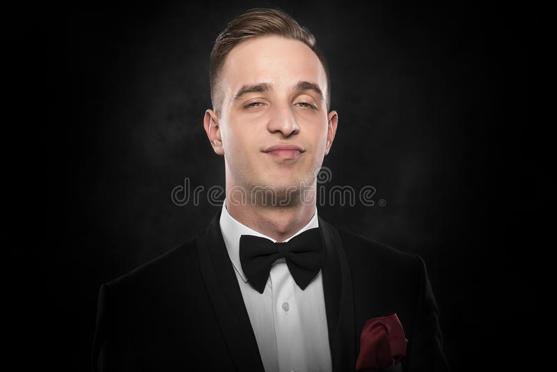 Highly successful business man in suit. Highly successful business man in suit over dark background royalty free stock photography