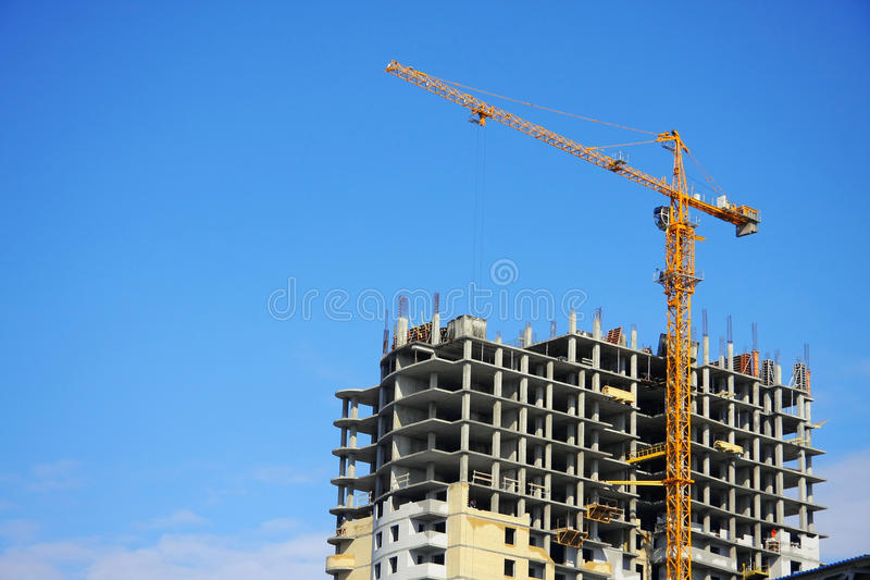 Download Highrise Construction Site On Clear Blue Sky Stock Image - Image: 12491055