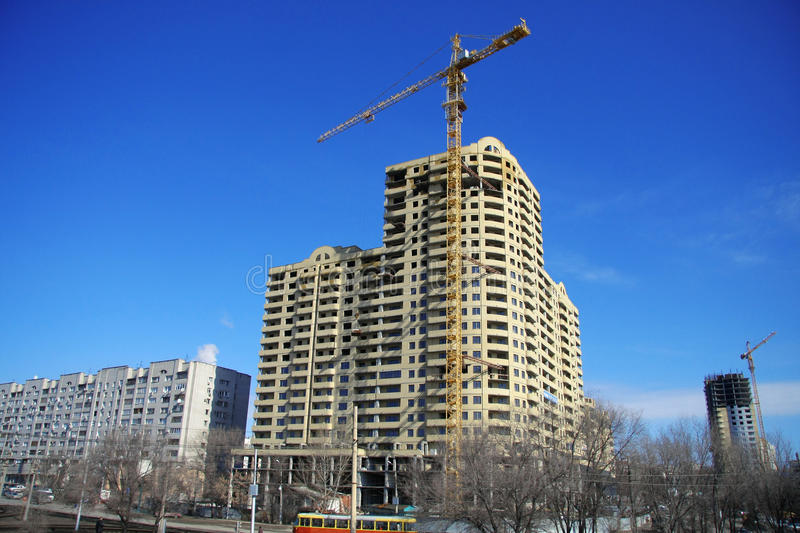 Download Highrise Construction Site On Clear Blue Sky Stock Photo - Image: 12491880