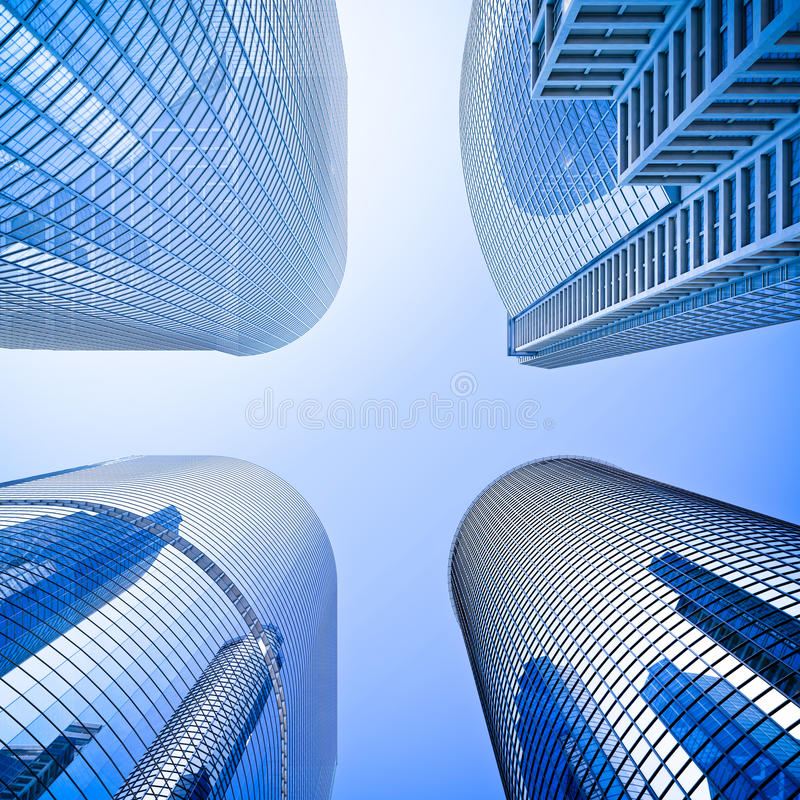 Blue Highrise Glass Skyscraper Intersection Low Angle Shot: Highrise Intersection Low Angle Shot Stock Illustration