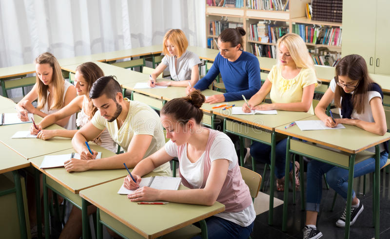 Highschool students learning in classroom stock images