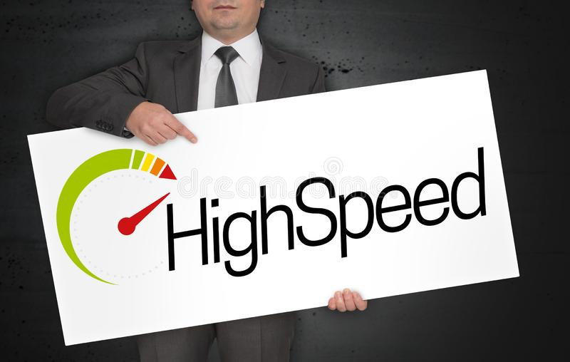 Highspeed poster is held by businessman.  royalty free stock photography