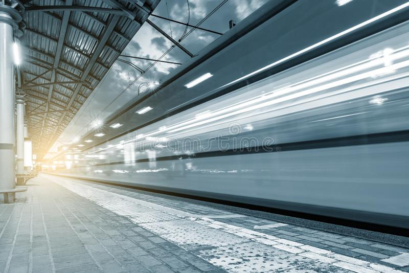 Highspeed train arrives to the station platform. Highspeed train arrives to the station platform at evening time stock photo