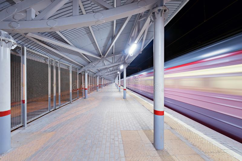 Highspeed train arrives to the station platform. Highspeed train arrives to the station platform at night time royalty free stock images