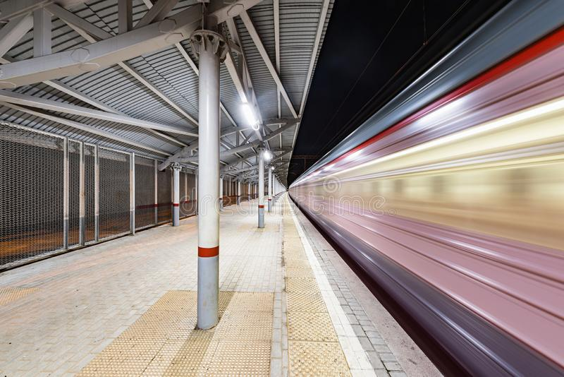 Highspeed train arrives to the station platform. Highspeed train arrives to the station platform at night time stock photography