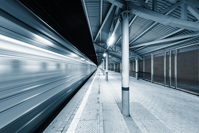 Highspeed train arrives to the station platform. Highspeed train arrives to the station platform at night time stock images