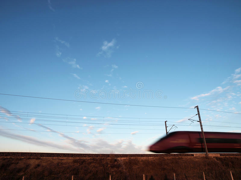 Highspeed train blurred effect. Highspeed train with bluesky as background stock photos