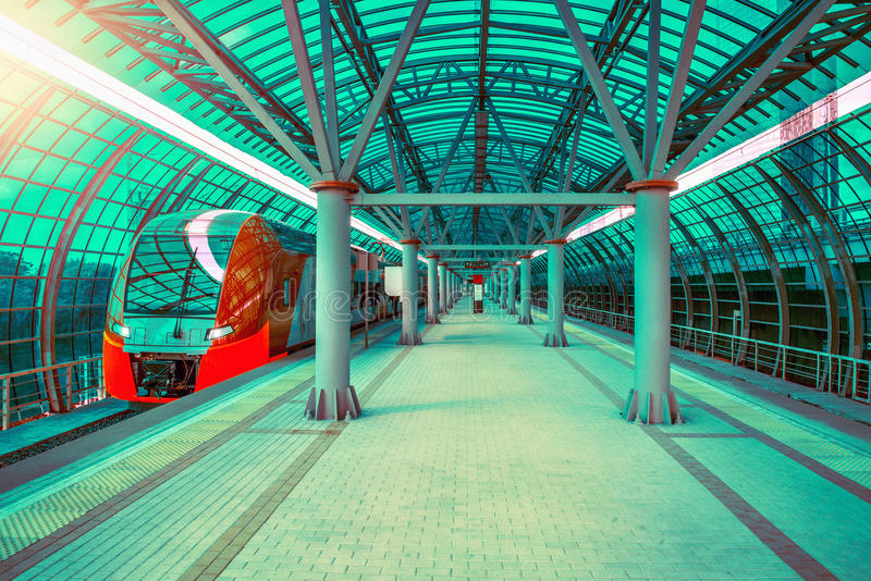 Highspeed train departs from the platform. Highspeed train departs from the platform at day time stock images