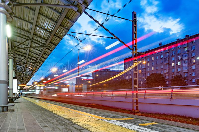 Highspeed train departs from the station platform. Highspeed train departs from the station platform at evening time stock image