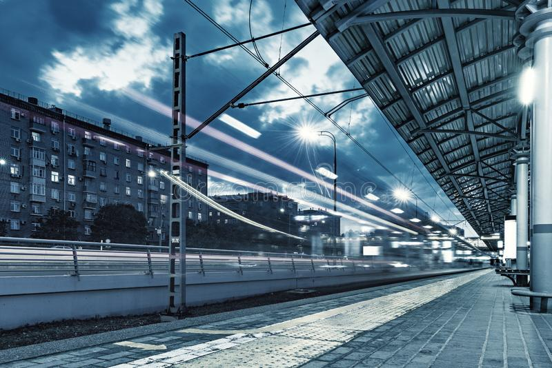 Highspeed train departs from the station platform. Highspeed train departs from the station platform at evening time stock images