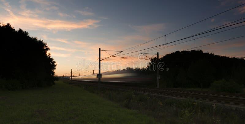 Highspeed train at dusk. Motion blur stock photo