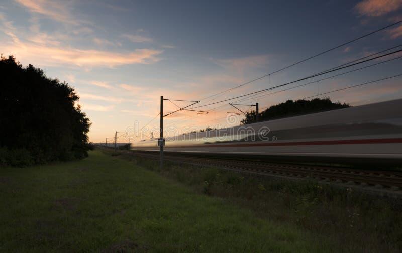 Highspeed train at dusk. Motion blur stock image