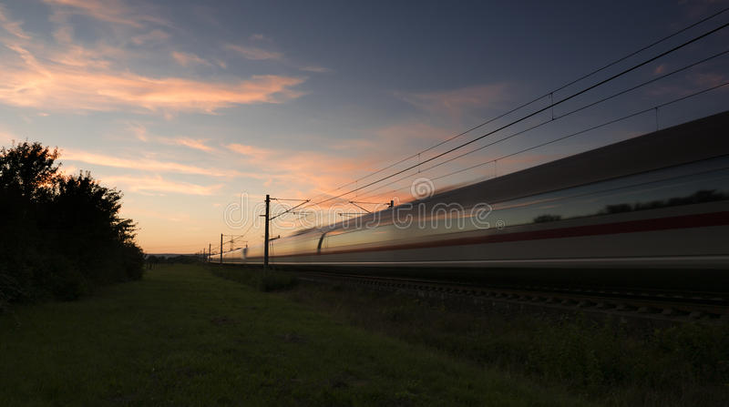 Highspeed train at dusk. Motion blur stock photography