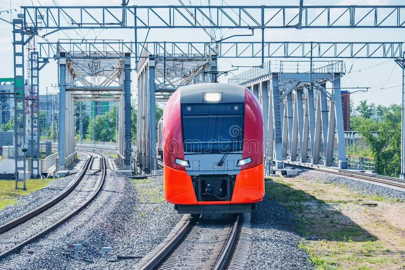 Highspeed train moves from the bridge. Highspeed train moves toward from the bridge at day time royalty free stock photos