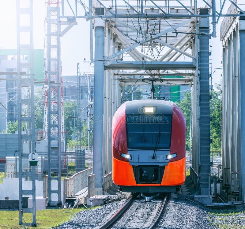 Highspeed train moves on the bridge. Highspeed train moves toward on the bridge at day time stock photos